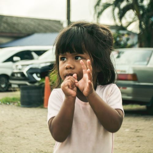 Childhood Real People Front View Casual Clothing Day One Person Portrait Looking At Camera Happiness Elementary Age Cute Outdoors Smiling Eating Making A Face Human Hand Close-up People