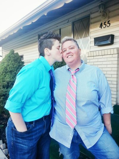 Lgbt Family Queer Women Gender Blue Building Exterior Couple Gay Home Kiss Lesbian Lgbt Lifestyles Looking At Camera Outdoors Person Portrait Smartphonephotography Smiling Standing Togetherness Women