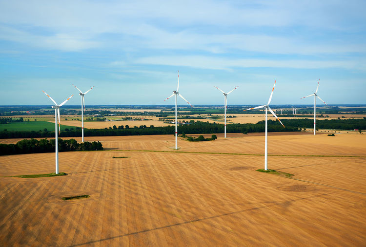 Windmills against sky
