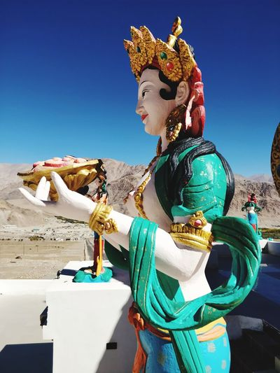 Statue Tibetan  EyeEm Selects Clear Sky Portrait Blue Arts Culture And Entertainment Glamour Sky Make-up Lip Gloss Moving Around Rome Stories From The City EyeEmNewHere California Dreamin Go Higher This Is Queer Inner Power