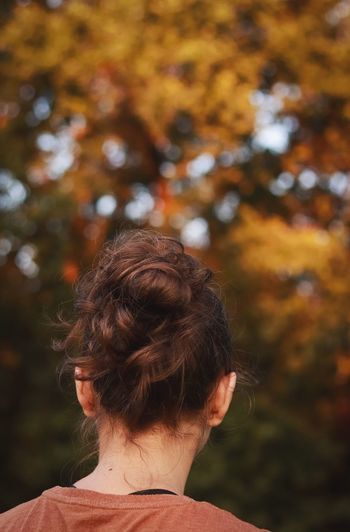 Rear view of woman with hair bun outdoors
