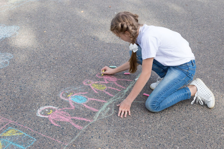 children draw in crayon on asphalt Happiness Friendship Doodle Sketching Game Chalking Pavement Colorful Activity Creative Playground Happy Lifestyle Playing Coloring Painting Leisure Activity Leisure Education Artist Cute Play People Image Draw Art Outside Street Sidewalk Close Up Hand Color Fun Outdoor Day Summer Crayons Children Family Chalk Drawing Asphalt Creativity Child Childhood Girl Teenager Teen Copy Space Copyspace