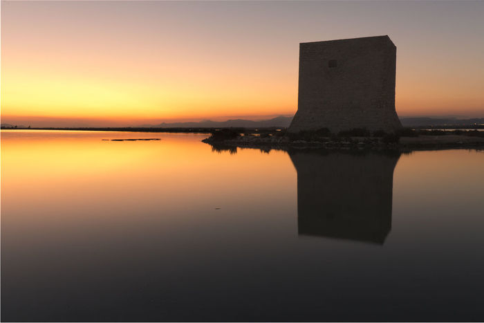 Tower of Tamarit at sunset in the town of Santa Pola, province of Alicante in Spain Alicante European  SPAIN Santa Pola Spanish Beauty In Nature Dawn Horizon Over Water Nature No People Orange Color Outdoors Reflection Scenics Sea Silhouette Sky Sun Sunset Symmetry Tamarit Tower Of Tamarit Tranquil Scene Tranquility Water Waterfront