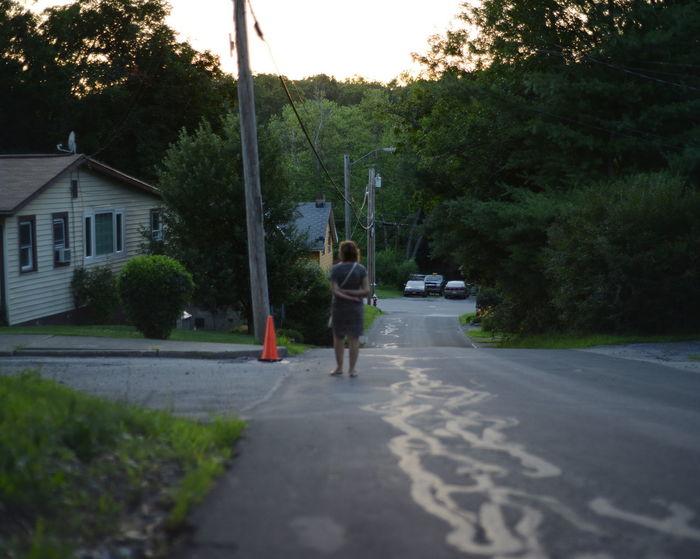 Street Downhill Woman Standing Suburbia Rual Beacon Summer Evening Green Nature