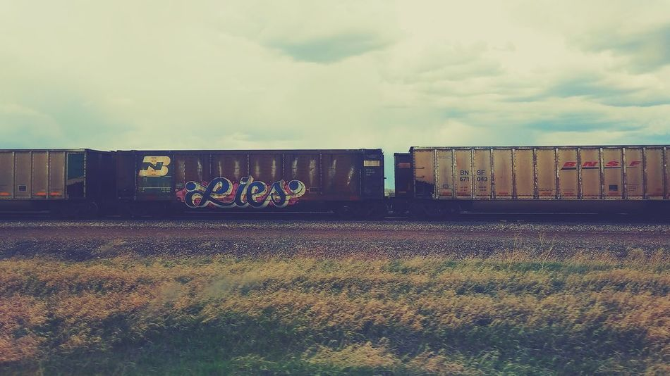 BNSF Trains Railroad Track Train Graffiti  Train Cars Graffiti Wyoming Check This Out Word Art Abstract First Eyeem Photo