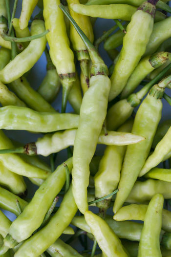 Full frame shot of green chili peppers for sale at market