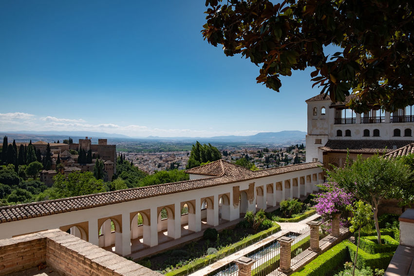Alhambra (Granada) Alhambra De Granada  Granada Granada, Spain Alhambra Architecture Beauty In Nature Building Building Exterior Built Structure City Day Growth Mountain Mountain Range Nature No People Outdoors Plant Railing Residential District Scenics - Nature Sky Travel Destinations Tree