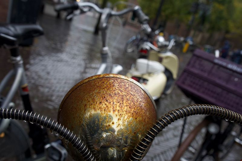 Rusty the robot surveys his surroundings... Utrecht, Netherlands Utrecht Netherlands Wet Street Rainy Days Rain Scooters Scooter Rusted Metal  Rusted Rust EyeEm Selects Focus On Foreground Close-up Metal No People Lighting Equipment Illuminated Street Selective Focus Land Vehicle Technology Transportation Mode Of Transportation Silver Colored First Eyeem Photo