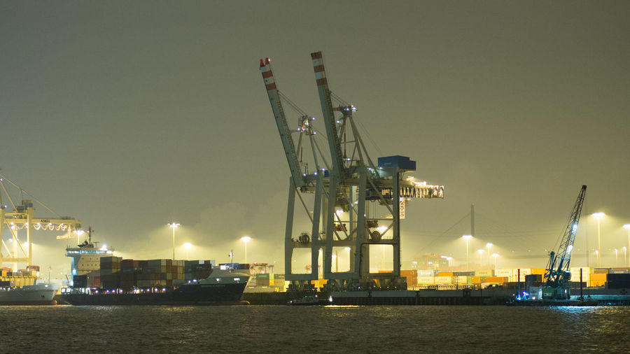 Cranes at commercial dock at night