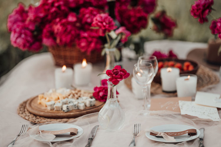 Close-up of various flowers on table
