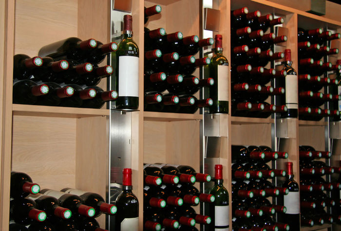 wine bottles in a rack - saint-emilion, france Abundance Alcohol Blank Label Bottle Cellar Choice For Sale France In A Row Indoors  Large Group Of Objects No People Red Wine Retail  Saint-Emilion Shelf Shop Storage Store Wine Wine Bottle Wine Cellar Wine Rack Winery Winetasting