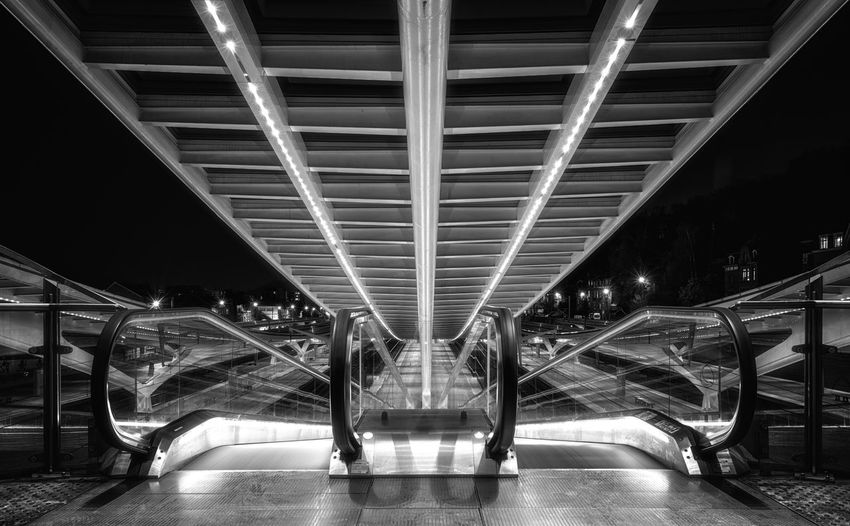 Modern escalator at night Illuminated Architecture Modern Built Structure Transportation Railing Escalator Lighting Equipment The Way Forward No People Direction Staircase Connection Empty Futuristic Ceiling Technology Moving Walkway  Night Long Exposure Bnw Blackandwhite Architecture Design Lines Stationary