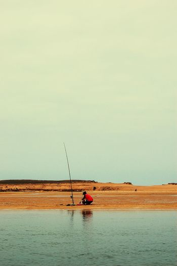 Lonely fisherman in Oualidia Fisherman Lonely Oualidia Morocco Travel MoroccoTrip Oualidia Lagoon Landscapes With WhiteWall Escapism Time To Reflect Traveling Travel Photography Seascape Landscape_Collection Copy Space Sea And Sky Fisherman Telling Stories Differently