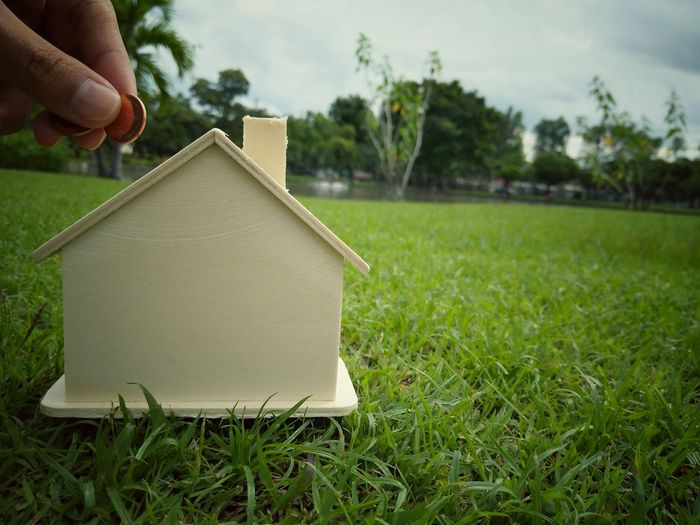 House Home Ownership Front Or Back Yard Residential Building Only Men Tree One Man Only One Person Moving House Outdoors People Human Hand Adult Human Body Part Adults Only Grass Day Tranquility Finance