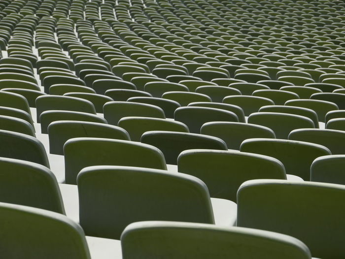 Absence Abundance Arrangement Backgrounds Bleachers Chair Empty Full Frame Green Color In A Row Indoors  Large Group Of Objects No People Order Pattern Repetition Seat Side By Side Sport Stadium 17.62°