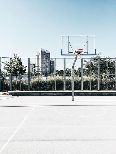 Basketball Court In City Against Clear Sky