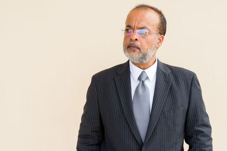 Man wearing mask against white background