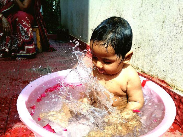 Full length of shirtless boy in water