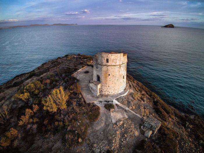 """La Torre Canai è situata nella parte meridionale dell'isola di Sant'Antioco, nell'arcipelago del Sulcis (Sardegna sud-occidentale), su un promontorio denominato """"Turri"""". Santantioco Panorama Sulcis Mare Torrespagnola Sardegna Land High Angle View First Eyeem Photo"""