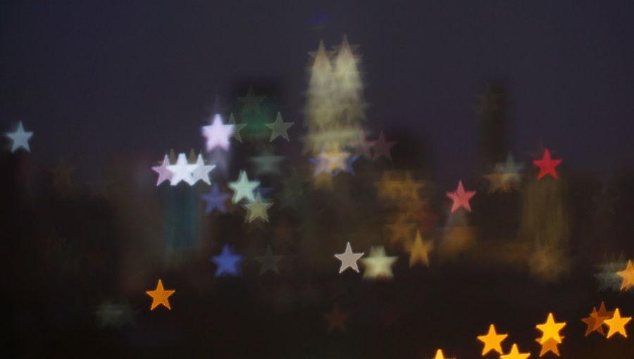 Malaysia city skyline illuminated at night Blurry photo light and bokeh. Celebration Christmas Christmas Decoration Cold Temperature Decoration Design Holiday Illuminated Nature Night No People Outdoors Plant Shape Sky Snow Snowflake Star Shape Tree
