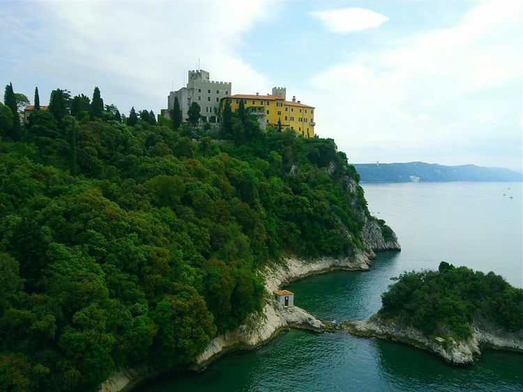 Castle Devin, Italy Duino Castle Italy Castle Castle View  Water Sea Architecture Building Exterior Tree Coastline Tranquility Scenics Waterfront Beauty In Nature Outdoors Cloud - Sky Sky Ocean Tranquil Scene Cloud Calm Tree