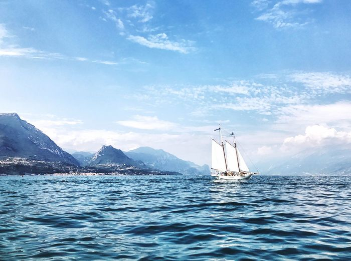 EyeEm Selects Beauty In Nature Horizon Over Water Water Lake View Boat Nautical Vessel Mountain Tranquil Scene Travel Destinations Summer Leisure Activity Sailing Lake Garda