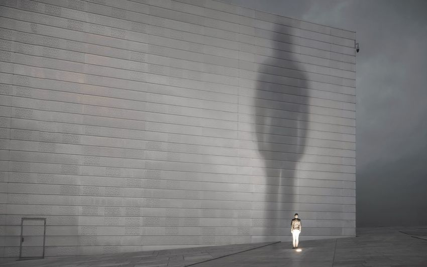 Statue Of Man Against Wall