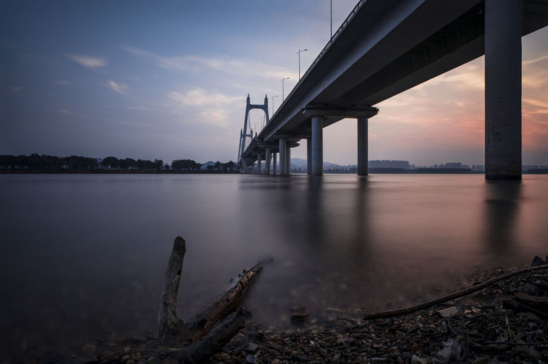 the riverside of the Sanchaji Architectural Column Architecture Bridge Bridge - Man Made Structure Built Structure Cloud - Sky Connection Nature No People Outdoors Reflection River Scenics - Nature Sky Sunset Tranquility Transportation Underneath Water