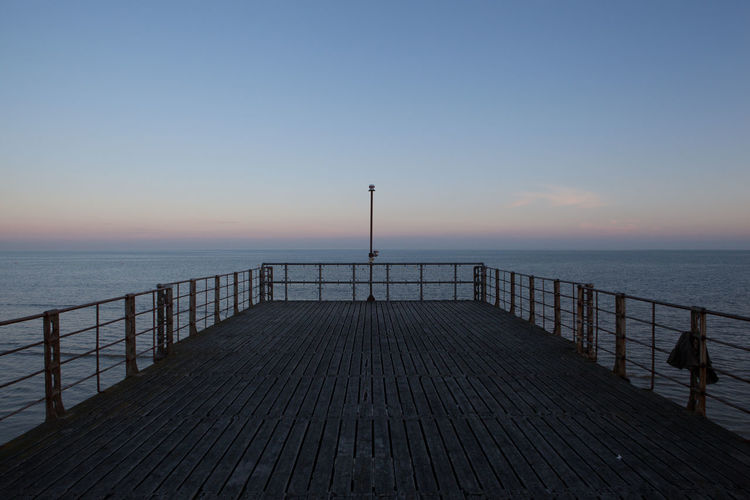 The pier at Bognor Beauty In Nature Blue Bognor Regis Copy Space Dramatic Sky Dusk England English Channel Horizon Over Water Idyllic Jetty No People Pier Pier Railing Resort Scenics Sea Seascape Seaside Summer Sunset Tranquil Scene Tranquility Water