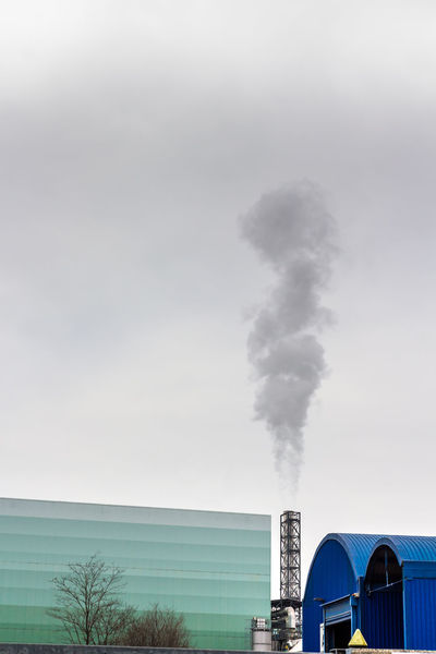 Pollution of a factory with smog and chimney smoke Air Atmosphere Chimney Climate Cloud Dirty Ecology Energy Environment Environmental Factory Fog Fumes Gas Global Industrial Industry Manufacturing Nature Pipe Plant Polluted Pollution Power Refinery