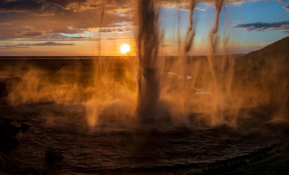 Behind the waterfall Seljalandsfoss at sunset Sunset Sky Scenics - Nature Nature Beauty In Nature No People Motion Water Sunlight Orange Color Outdoors Blurred Motion Non-urban Scene Tranquility Tranquil Scene Power In Nature Waterfall Iceland Foss Seljalandsfoss
