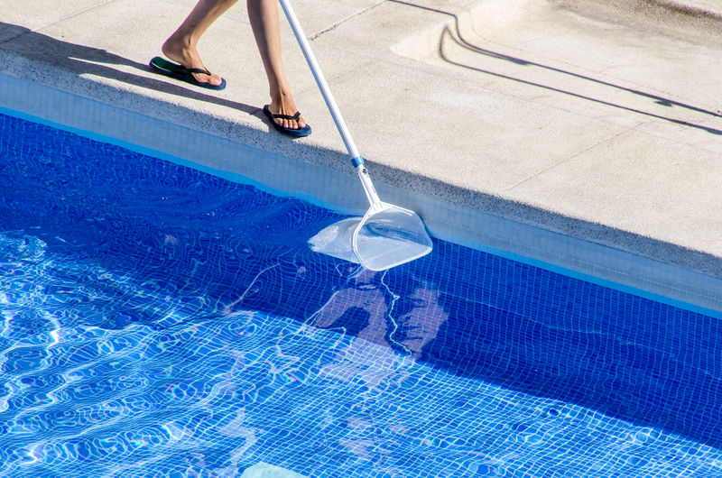 Cleaner Cleaning New York Service Blue Body Part Boy Day Flip Flops Human Leg Janitor Leisure Activity Low Section Nature One Person Outdoors Pool Poolside Swimming Pool Vacuum Tube Water