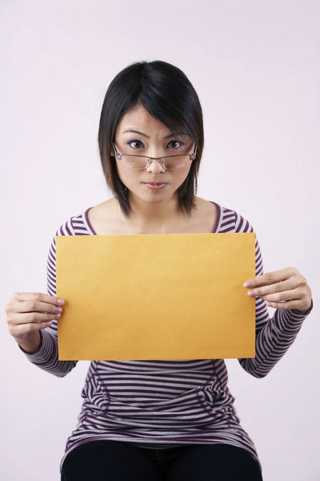 chinese woman holding placard Asian  Copy Space Happiness Student Beautiful Woman Black Hair Blank Casual Clothing Chinese Education Eyesglasses Facial Expression Girl Headshot One Person Placard Real People Showing Smiling Studio Shot Teenager University Student White Background Women Young Adult