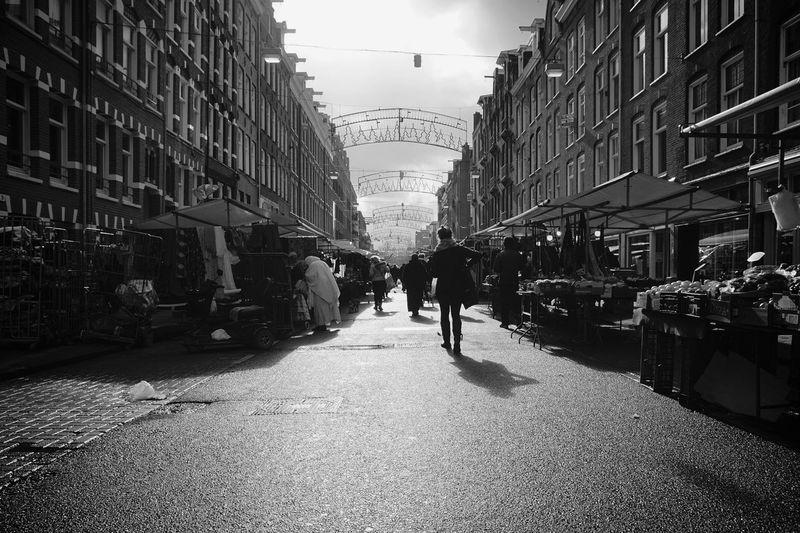 People Walking On Street At Market In City