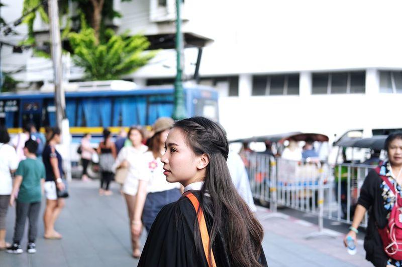 Portrait of teenage girl looking at city street