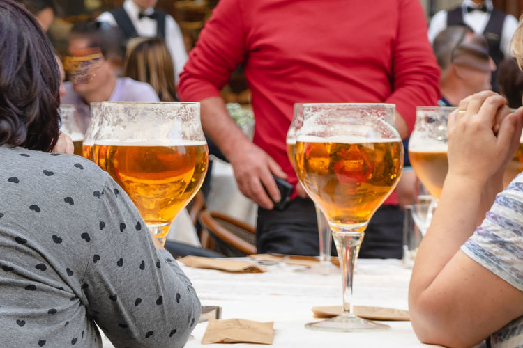 Group of people drinking glass on table