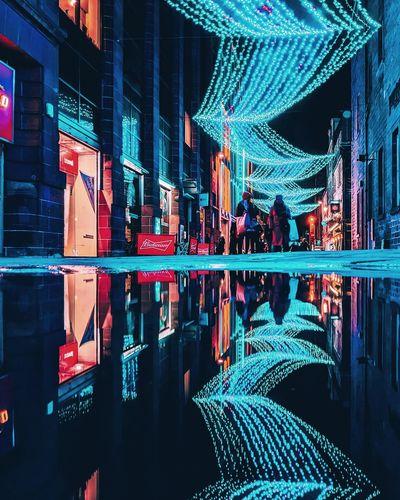 Digital composite image of illuminated buildings at night
