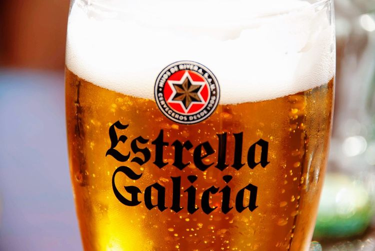 Estrella Galicia beer Balearic Islands Spanish Mallorca SPAIN Estrella Galicia Beer Drink Alcohol Beer - Alcohol Refreshment Glass Close-up Beer Glass Drinking Glass Glass - Material Food And Drink Focus On Foreground No People Still Life Text Frothy Drink
