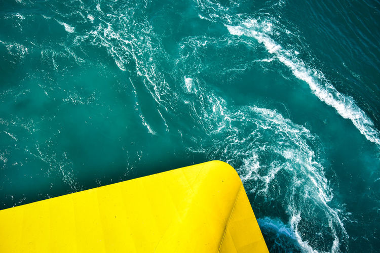 High angle view of yellow boat in sea