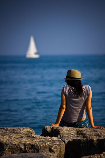 The girl and the boat Beauty In Nature Blue Boat Girl Horizon Over Water Lake Ontario Looking At View Outdoors Relaxation Ship Tourism Tranquility First Eyeem Photo