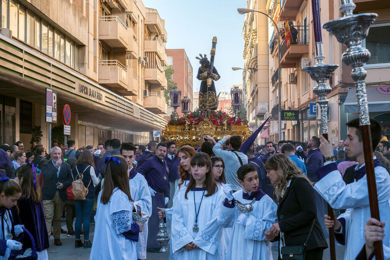 People in the procession in the Holy Week (Semana Santa) in a Spanish city. Malaga, Spain - March 26, 2018. Catolic Church Children Easter Easter Ready Historical Building Holy Week Malaga People Watching SPAIN Semana Santa Spanish Uniform Uniforms Adult Architecture Belief Building Building Exterior Built Structure Catolicism City City Life Crowd Day España Group Of People Large Group Of People Lifestyles Men Musical Instrument Musician Musician Bands Old Buildings Old City Procession Real People Religion Spain Is Different Spanish Arquitecture Spanish Culture Spirituality Street Women EyeEmNewHere Adventures In The City The Street Photographer - 2018 EyeEm Awards The Great Outdoors - 2018 EyeEm Awards The Traveler - 2018 EyeEm Awards