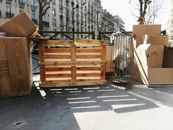 Urban Landscape Streetphotography Daylight Wooden Fence Wooden Pallet Garbage Street Garbage Boxes From The Store Metal Work Cardboard Up Close Street Photography The Street Photographer - 2016 EyeEm Awards The City Light