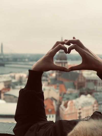 Riga View Riga Human Hand Hand Real People Heart Shape One Person Sky Positive Emotion Focus On Foreground