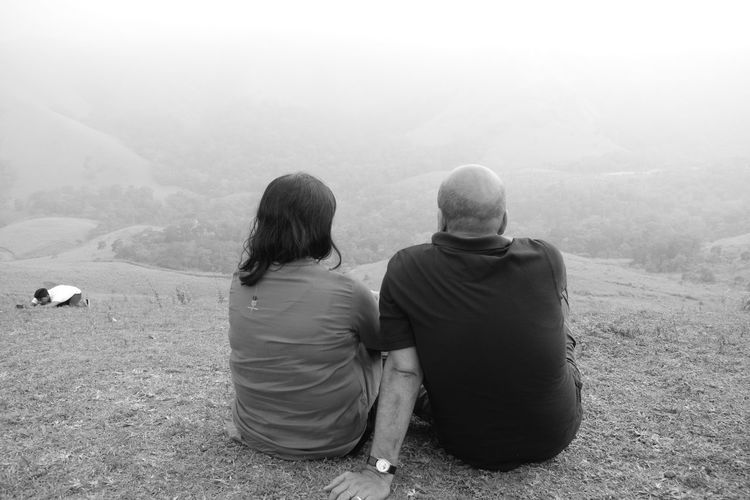 Two People Rear View Togetherness Heterosexual Couple Couple - Relationship Women Outdoors Adults Only Bonding People Friendship Fog Sitting Happiness Adult Leisure Activity Day Sky Men Nature Miles Away Welcome To Black Long Goodbye