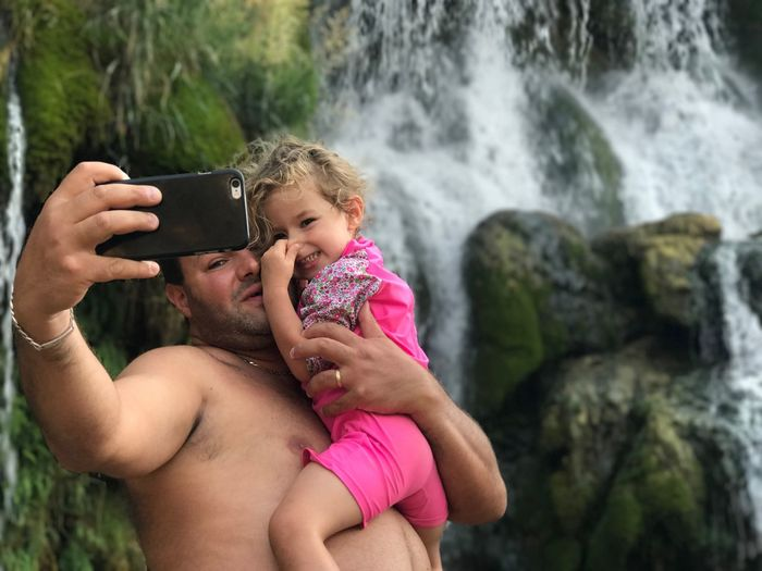 EyeEm Selects Kravica, Bosnia & Herzegovina Kravice Waterfall Waterfalls Two People Togetherness Wireless Technology Childhood Technology Leisure Activity Bonding Holding Portable Information Device Day Photography Themes Nature Outdoors Real People Selfie Young Adult People Adult