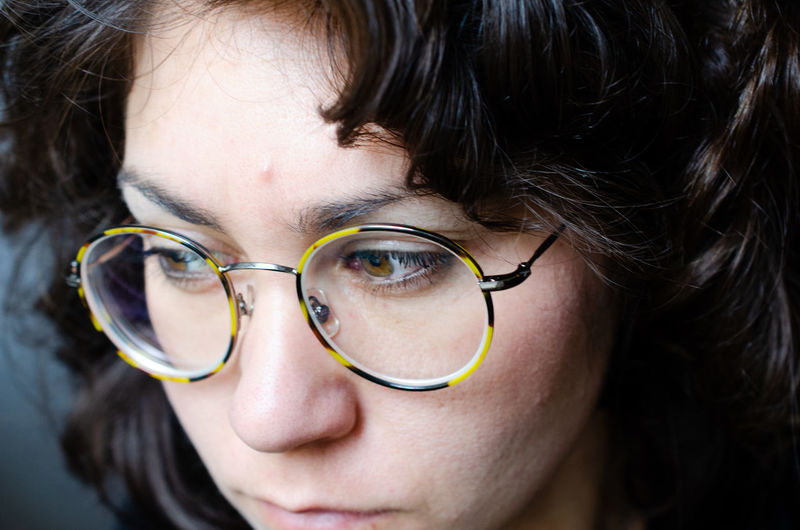 Close-up portrait of woman with eyeglasses