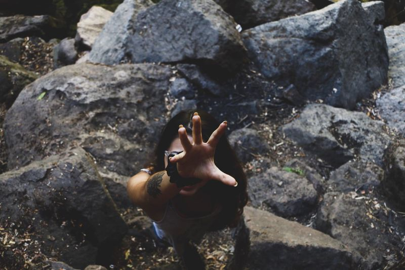 Rock Solid Rock - Object Real People One Person Lifestyles Visual Creativity Day Leisure Activity Sunlight Nature High Angle View Human Hand Hand Water Human Body Part Unrecognizable Person Outdoors Body Part Finger