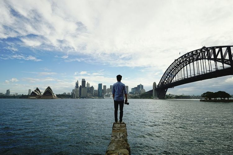 Bridge - Man Made Structure Tourist City Full Length Travel Harbor Travel Destinations Tourism Cloud - Sky People Rear View Scenics Outdoors Vacations EyeEmNewHere Urban Skyline Adults Only Cityscape Adult Architecture Built Structure Iconic Landmark Iconicbridge Manmadestructures Sydney Opera House