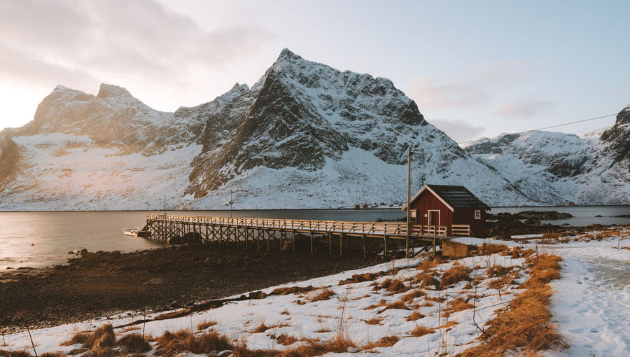 early mornings in Lofoten. find more travel inspiration at http://www.instagram.com/simonmigaj Beautiful Norway Pier Travel Beauty In Nature Built Structure Cold Temperature Dawn Day Frozen Iceberg Jetty Lofoten Mountain Mountain Range Nature No People Outdoors Scenics Snow Snowcapped Mountain Sunrise Tranquility Water Winter