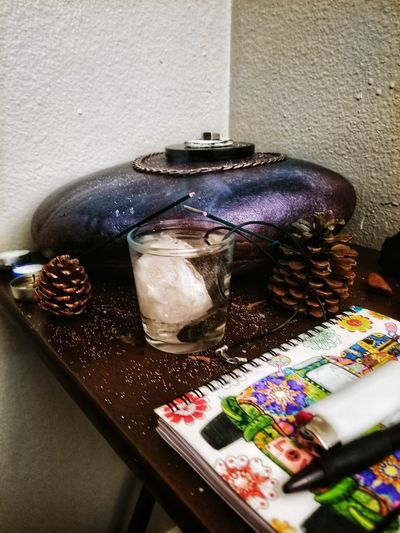 Magick at my altar Smokeyquartz Holywater  Salt Magick Magic Altar Altarstone Stone Rock Altarrock Purple Bookofshadows Witch Incense Crystals Quartz Rose Quartz Pinecone Chain Scryingmirror Charging Energy Spellwork Spell Wicca  Wiccan Table Close-up